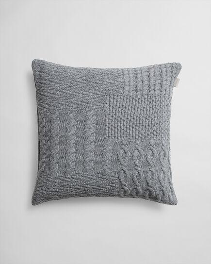 Kissenhülle mit Patchwork-Strickdesign