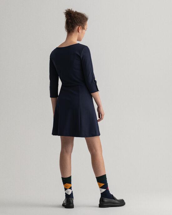 Jerseykleid mit goldfarbenen Knöpfen